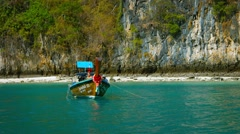 Handmade Wooden Longtail Boat Anchored off Phi Phi Island in Thailand - stock footage