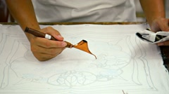 Artist sketching freehand with an instrument to create a traditional work of art Stock Footage