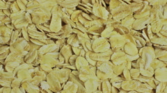 Close up of porridge oats as background or texture. Diet and healthy nutrition. Stock Footage