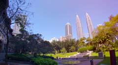 City Park Layed out before the Famous Petronas Towers in Downtown Kuala Lumpur Stock Footage