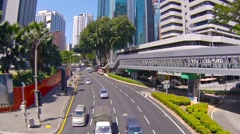 Traffic Speeds along a Major Urban Thoroughfare in a Commercial District - stock footage