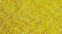 Close view of a layer of stone ground yellow corn meal Stock Footage
