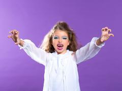 Children vampire makeup kid girl on purple - stock photo