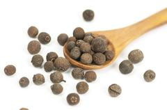 Allspice (Jamaica pepper) fruits on white Stock Photos