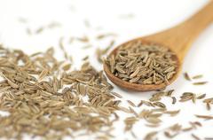Caraway (Carum carvi) seeds background - stock photo