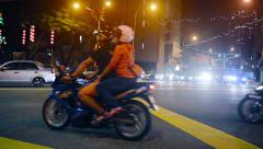 Night Time Traffic at a Typical Urban Intersection in Central Kuala Lumpur Stock Footage