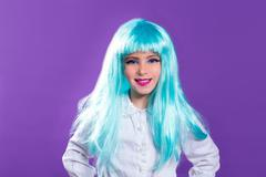 Stock Photo of Children girl with blue truquoise long wig as fashiondoll
