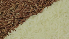 Background of natural brown and white rice seeds Stock Footage