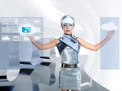 Stock Photo of futuristic children girl in silver touch finger icloud icon