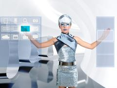 Stock Photo of futuristic children girl touch finger copyspace screen
