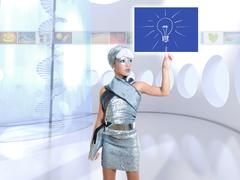 Stock Photo of futuristic children girl in silver touch finger idea light bulb