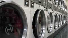 Dryer machines in a laundromat Stock Footage