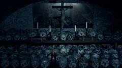 4k Skulls and Jesus cruzifix in Charnel House Hallstatt Austria Stock Footage