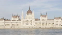 Parliament building in Budapest on Danube river banks 4K 2160p UHD video - Hu - stock footage
