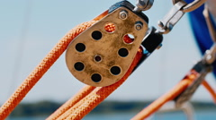 The block with a rope. Detail of sailing yacht Stock Footage