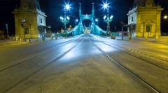 Tram and car traffic on the Liberty bridge by night Stock Footage