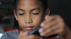 Boy having fun with game in smartphone Stock Footage