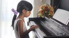 Learning to play piano Stock Footage