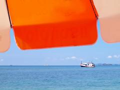 Sunshade with boat Stock Photos