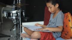Asian boy drawing cartoon - stock footage