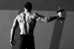 Dumbbell man rear view with back muscles - stock photo