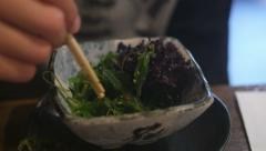 Eating seaweed salad - stock footage