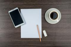 Tablet, paper, Eraser and pencil  with coffee - stock photo