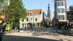 Canal bridge and Wester Tower in Amsterdam Stock Footage