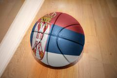 basketball ball with the national flag of serbia - stock illustration