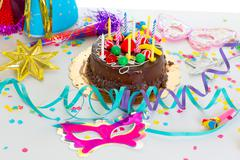 Children birthday party with chocolate cake - stock photo