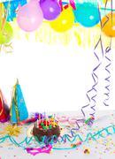 Children birthday party with chocolate cake Stock Photos