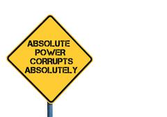 Stock Photo of Yellow roadsign with Absolute Power Corrupts Absolutely message