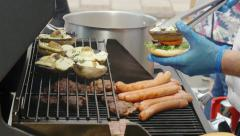 Cooking hamburger and hot dogs Stock Footage