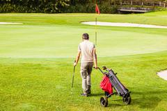 Approaching a golf hole - stock photo