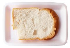 Bitten white bread - stock photo