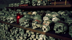 Memorial skulls in Charnel House at Hallstatt Austria Stock Footage