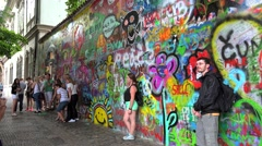 Tourists at the John Lennon Wall in Prague. Stock Footage