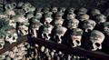 Skulls and bones in Charnel House at Hallstatt Austria HD Footage