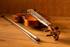 Classic music violin vintage in wooden background - stock photo