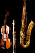 Music Sax tenor saxophone violin and clarinet in black - stock photo