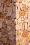 Masonry stone wall corner detail construcion work - stock photo