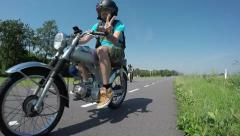Peace on oldtimer motorbikes riding past camera four stroke engines slow motion Stock Footage