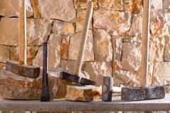 Stock Photo of Hammer tools of stonecutter masonry work