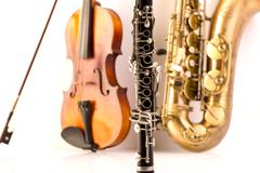Sax tenor saxophone violin and clarinet in white - stock photo