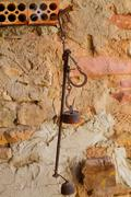 Antique scales rusted iron with weights - stock photo