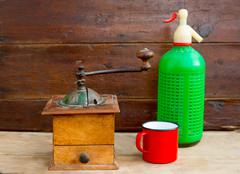 retro old coffee grinder and soda bottle vintage - stock photo