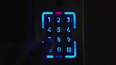 Fingers, press the button on the neon combination lock Stock Footage