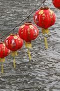 Chinese Lanterns Hanging over River for New Year Celebration - stock photo