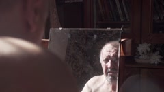 Onely single man It is looking in the mirror a sad sight slo-mo Stock Footage
