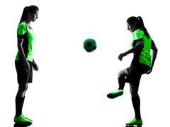 Women soccer players isolated silhouette Kuvituskuvat